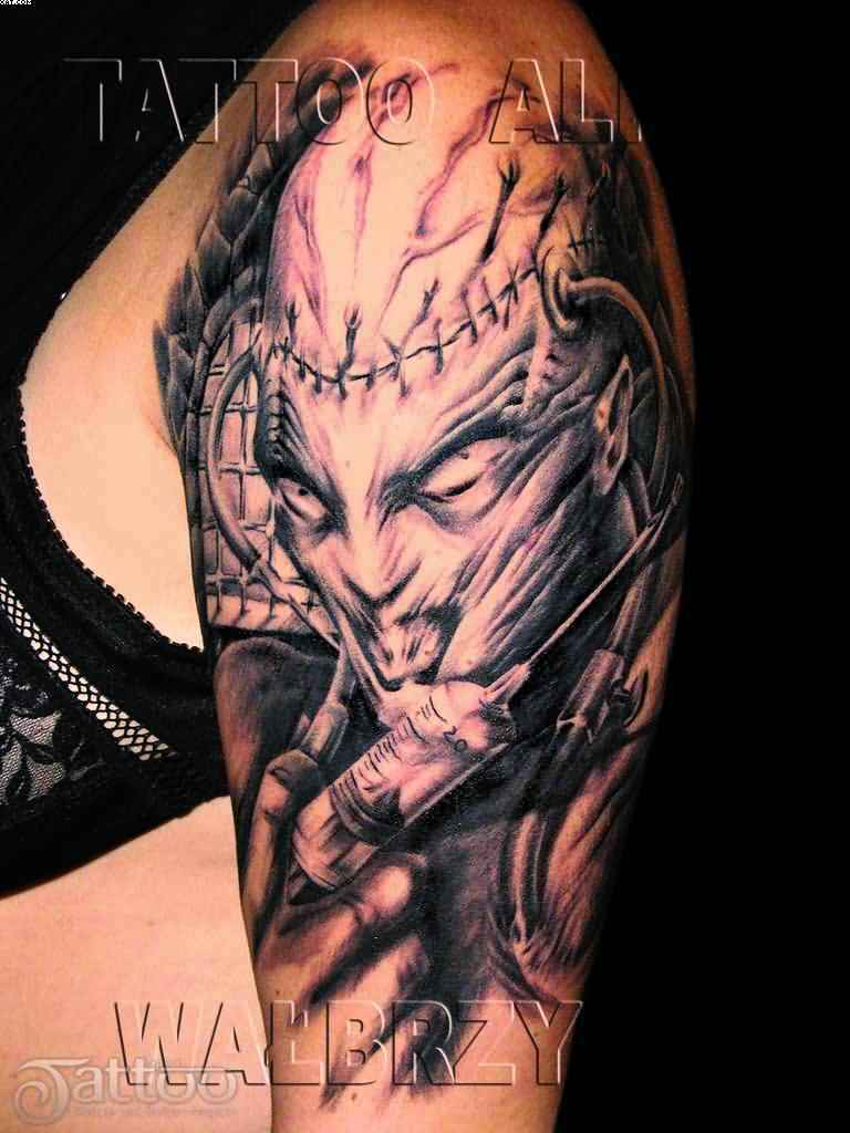 Scary alien with syringe tattoo on arm for Evil tattoo sleeve