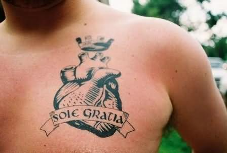 A Heart With Banner Tattoo On Chest