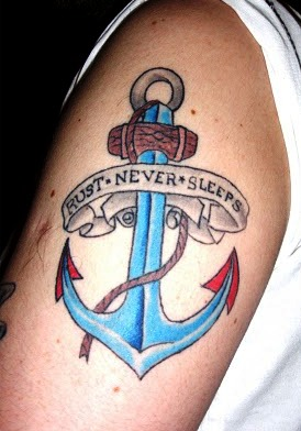 Anchor With Slogan Banner Tattoo On Arm