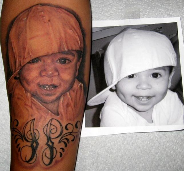Awesome Smiling Baby Tattoo Design