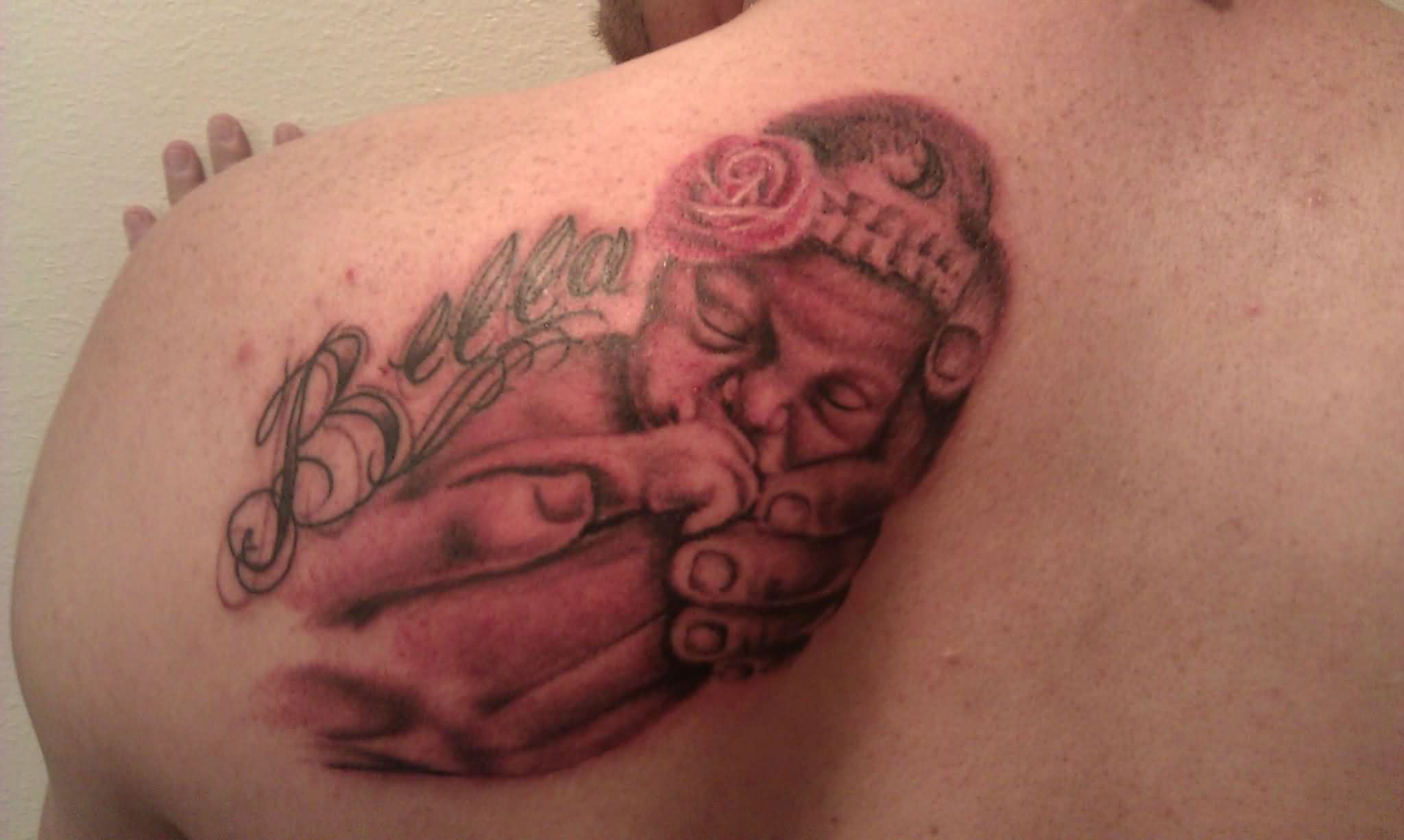 Baby Sleeping In Hands Tattoo On Shoulder Back