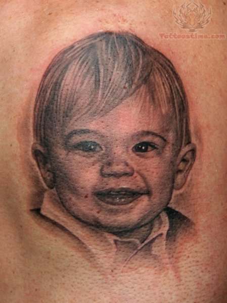 Cute Smiling Baby Tattoo