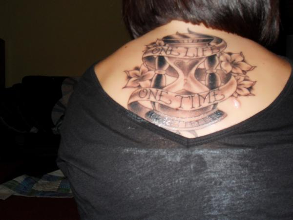 Sand Clock With Banner Tattoo On Upper Back