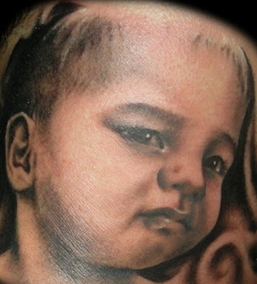 Simple Baby Face Portrait Tattoo Design