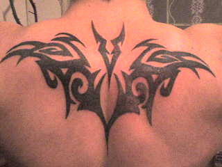 Tribal Bat Tattoo Design On Upper Back