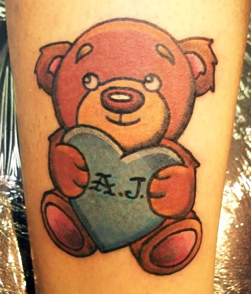 blue teddy bear with kuuipo text tattoo on upper sleeve. Black Bedroom Furniture Sets. Home Design Ideas