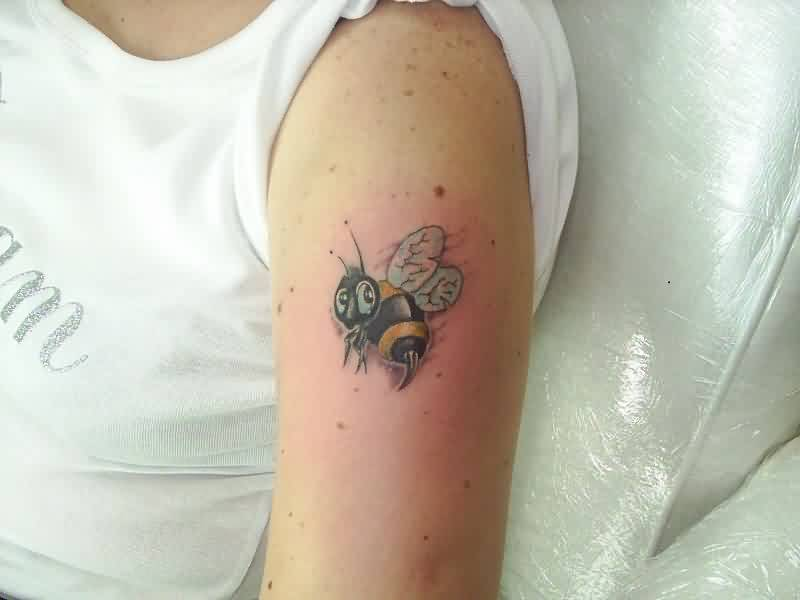 A Black And Yellow Bee Tattoo On Arm