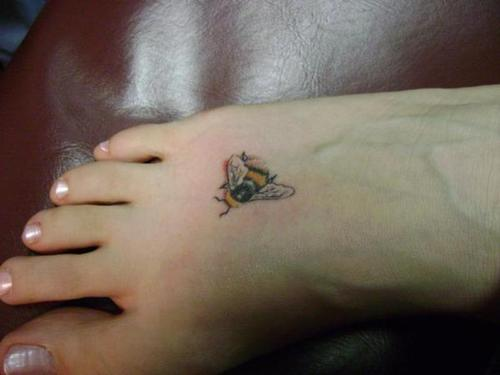 A Small Bee Tattoo On Foot For Women