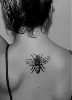 Black And White Honey Bee Tattoo On Upperback