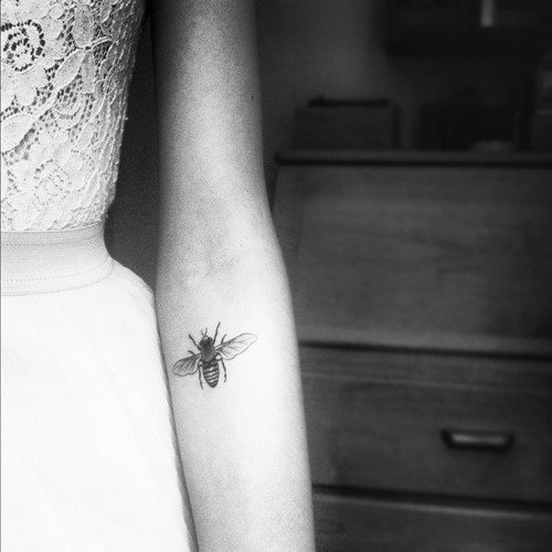 Black And White Small Bee Tattoo On Arm