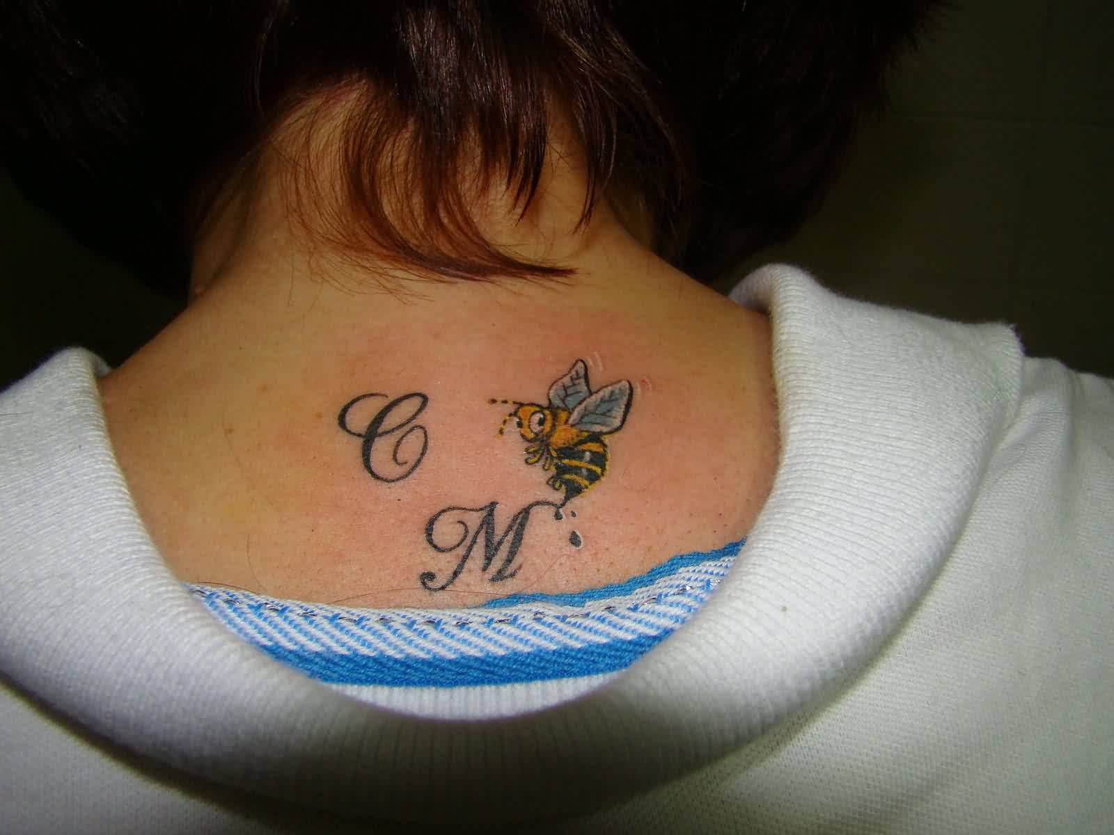 Initials And Little Bee Tattoo On Upperback