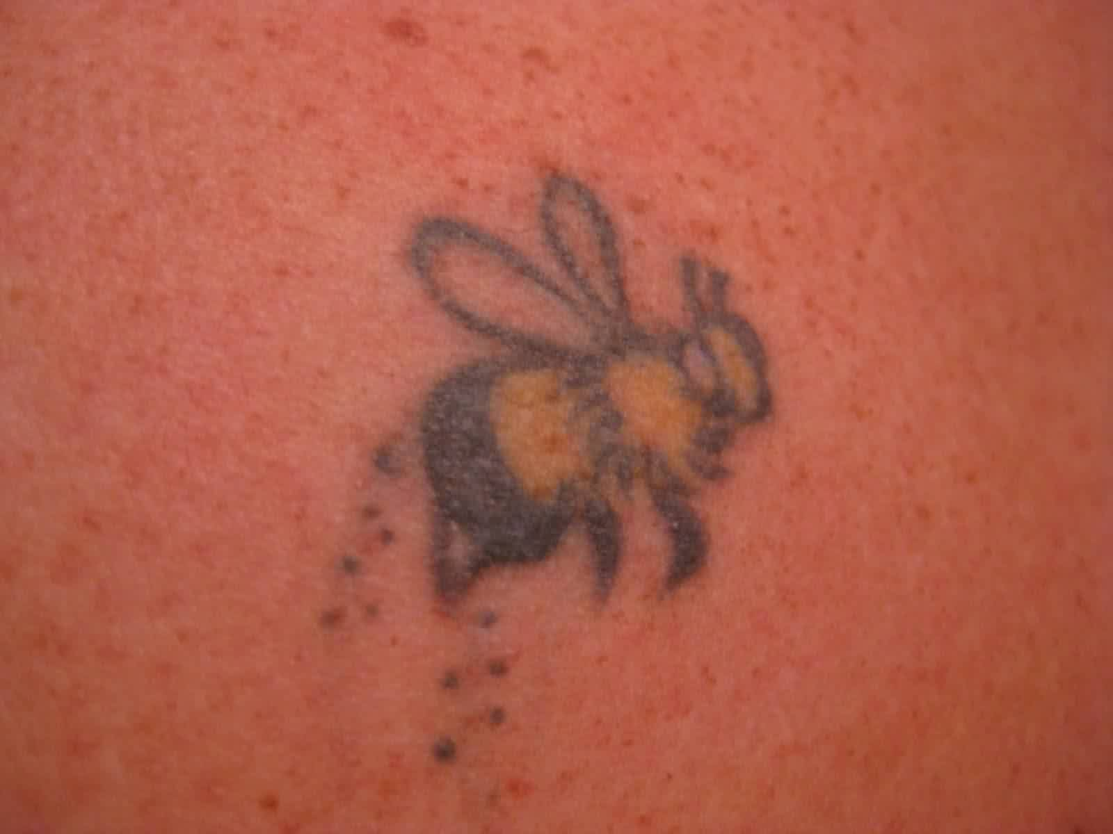 Small Black And Yellow Bee Tattoo
