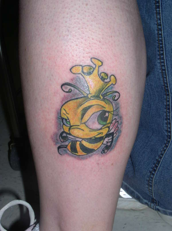 Yellow Queen Bee Tattoo On Side Of Leg