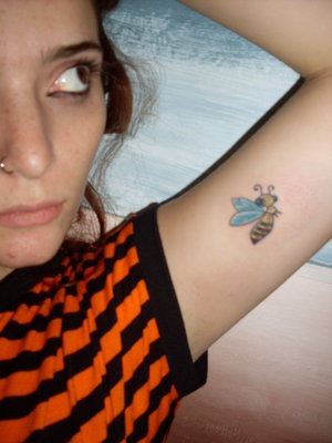 Young Girl With New Bee Tattoo On Inner Arm