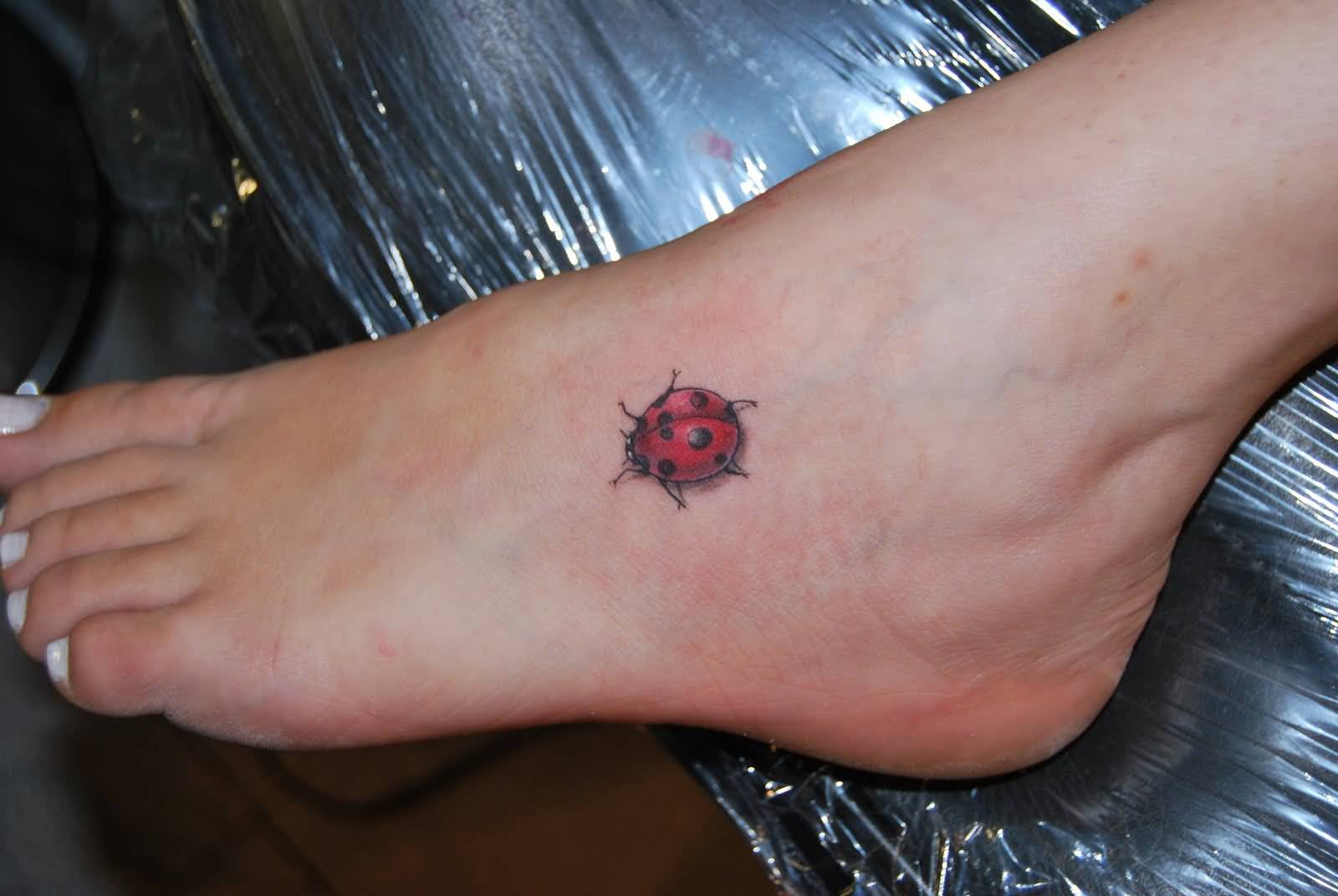 Fantastic Ladybug Tattoo On Foot Incredible