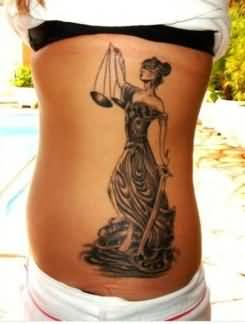 Pin up lady justice tattoo on ribs for Tattoos of lady justice