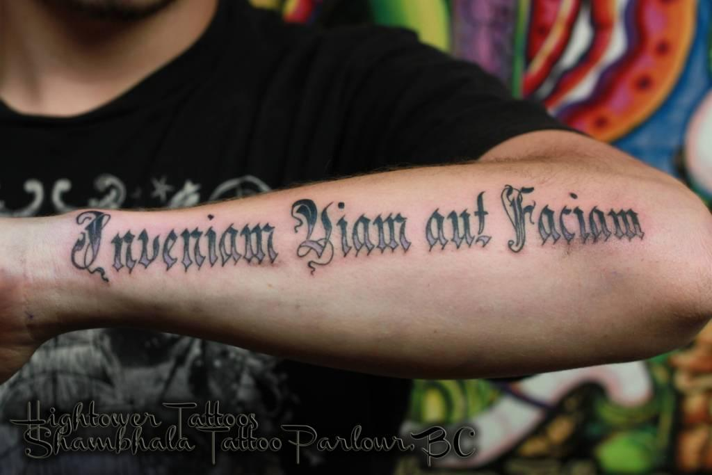 amazing lettering tattoo on forearm