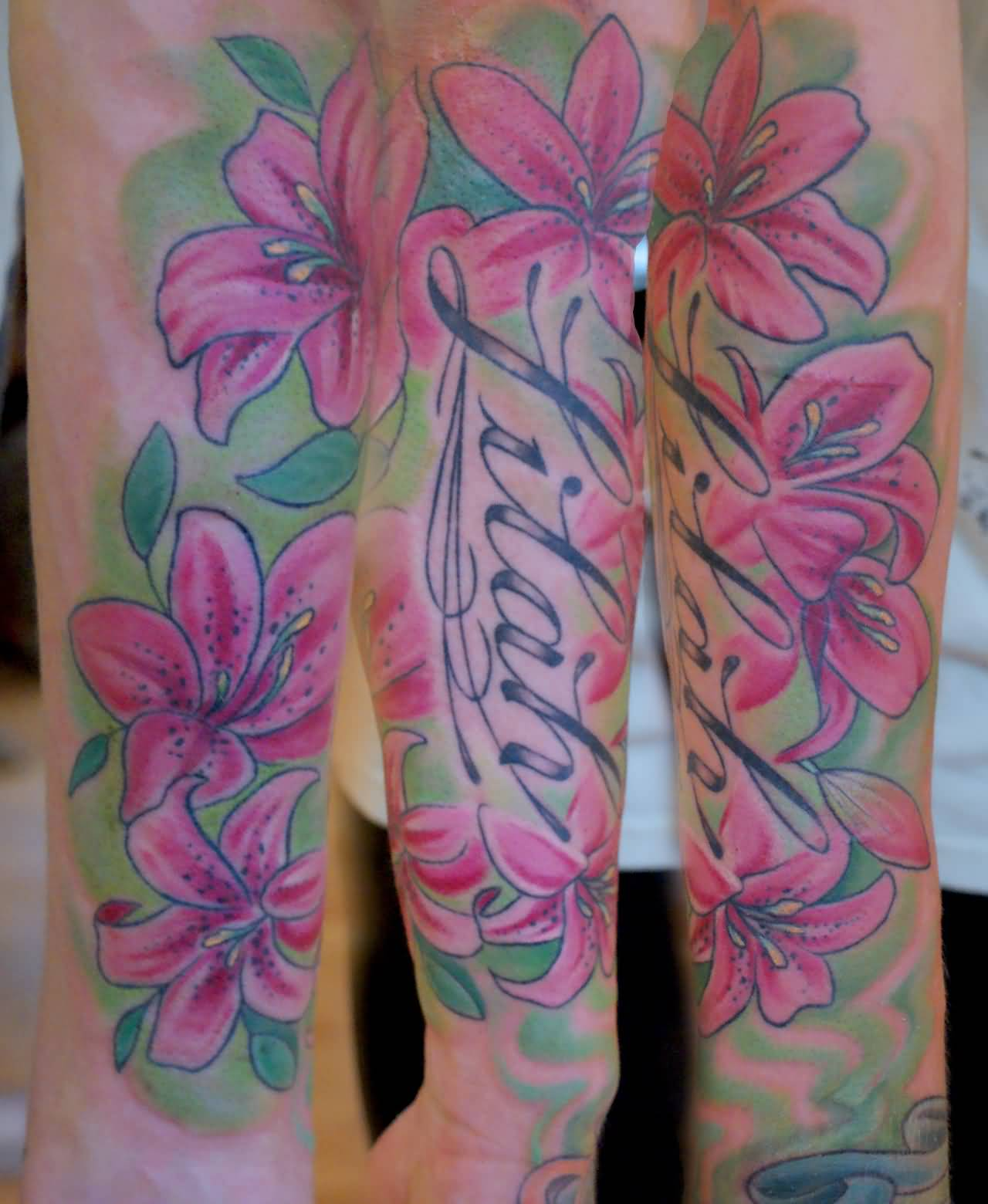Lily tattoo ideas and lily tattoo designs page 2 colored tattoo of lily flowers izmirmasajfo