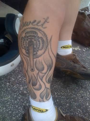 Gears Tattoo On Leg Decorated With Flames