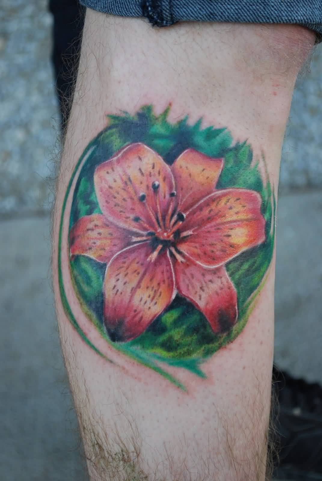 Lily tattoo ideas and lily tattoo designs lily flower with green background tattoo on calf izmirmasajfo