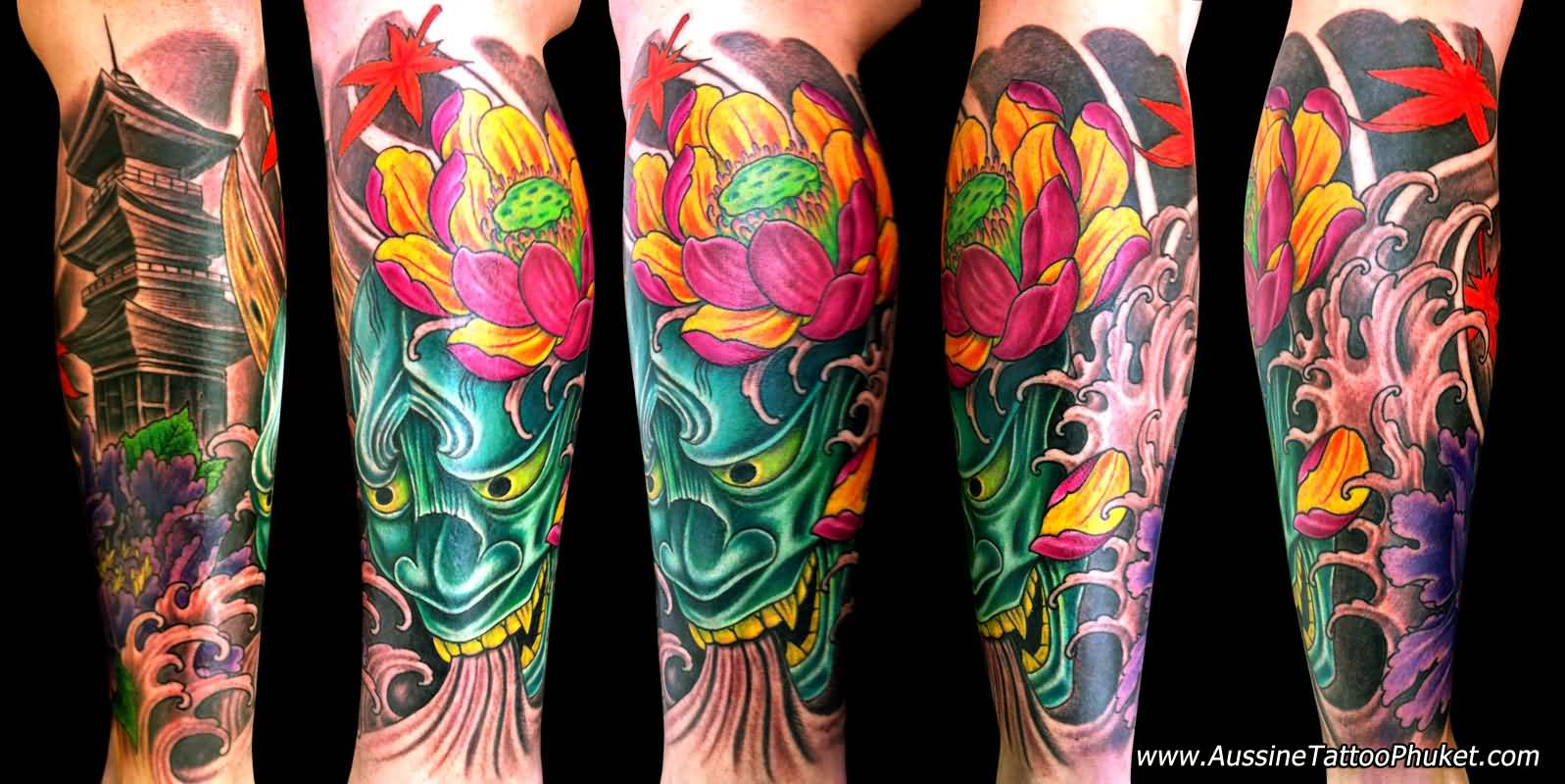 Amazing Green Mask Tattoo With Lotus Flower