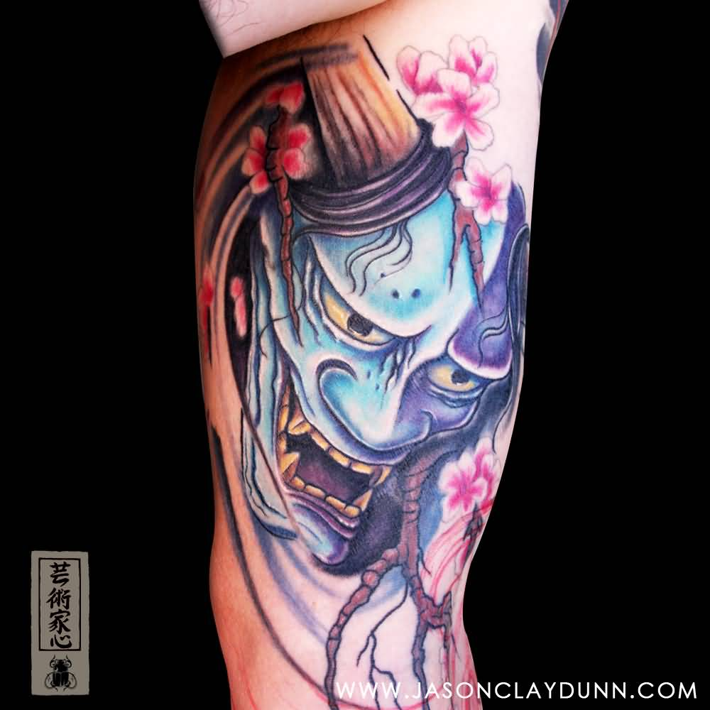 Amazing Mask Tattoo Of Devil With Flowers