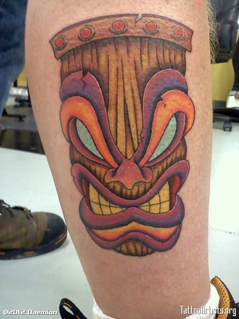 Angry Mask Face Tattoo On Calf