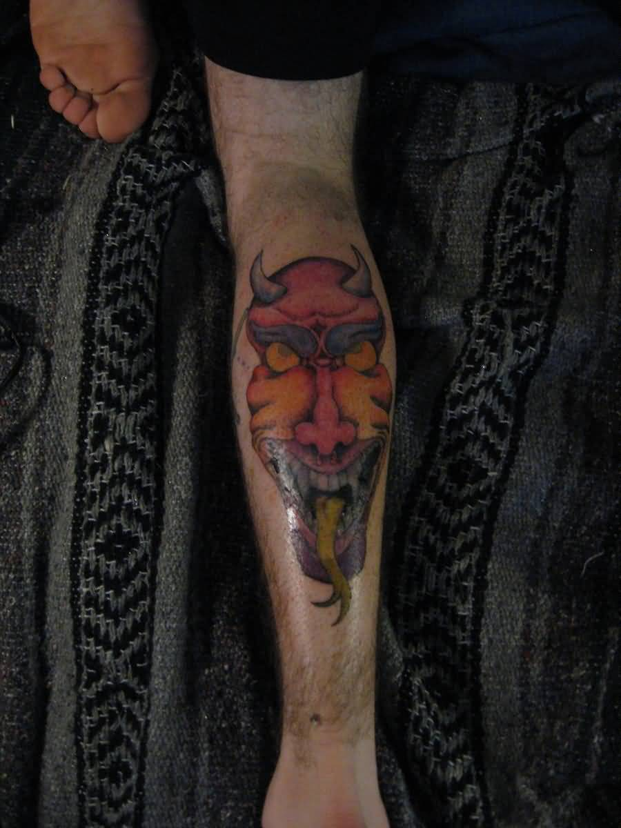 Attractive Oni Mask Tattoo Made On Calf
