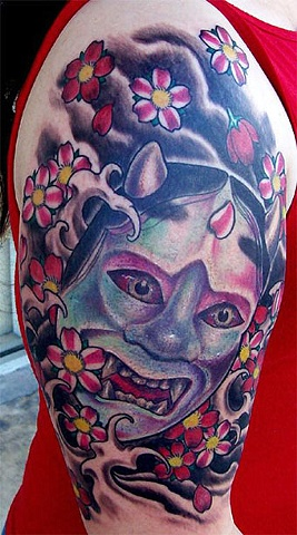 Attractive Oni Mask Tattoo On Shoulder