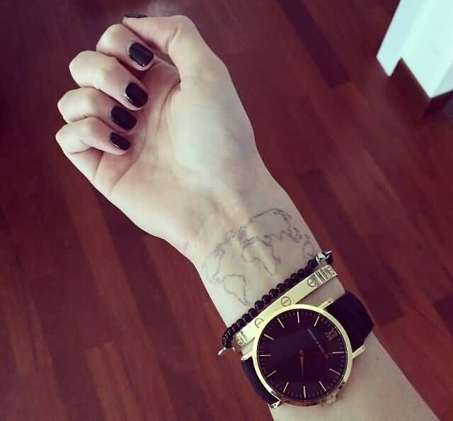 Gorgeous lady with tattoo of world map on wrist tattooshunter beautiful world map tattoo on wrist gumiabroncs Image collections