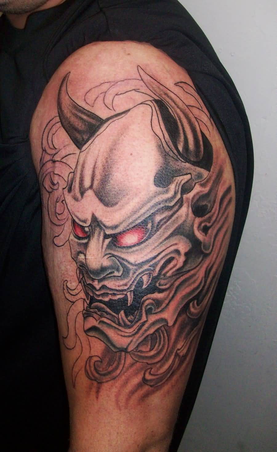 Best Mask Tattoo On Tricep With Red Eyes