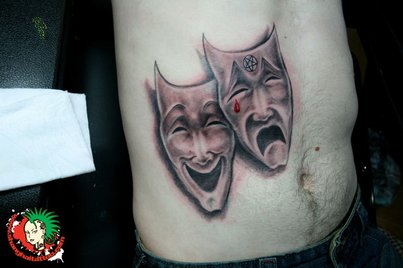 Brilliant Comedy Mask Tattoo On Stomach