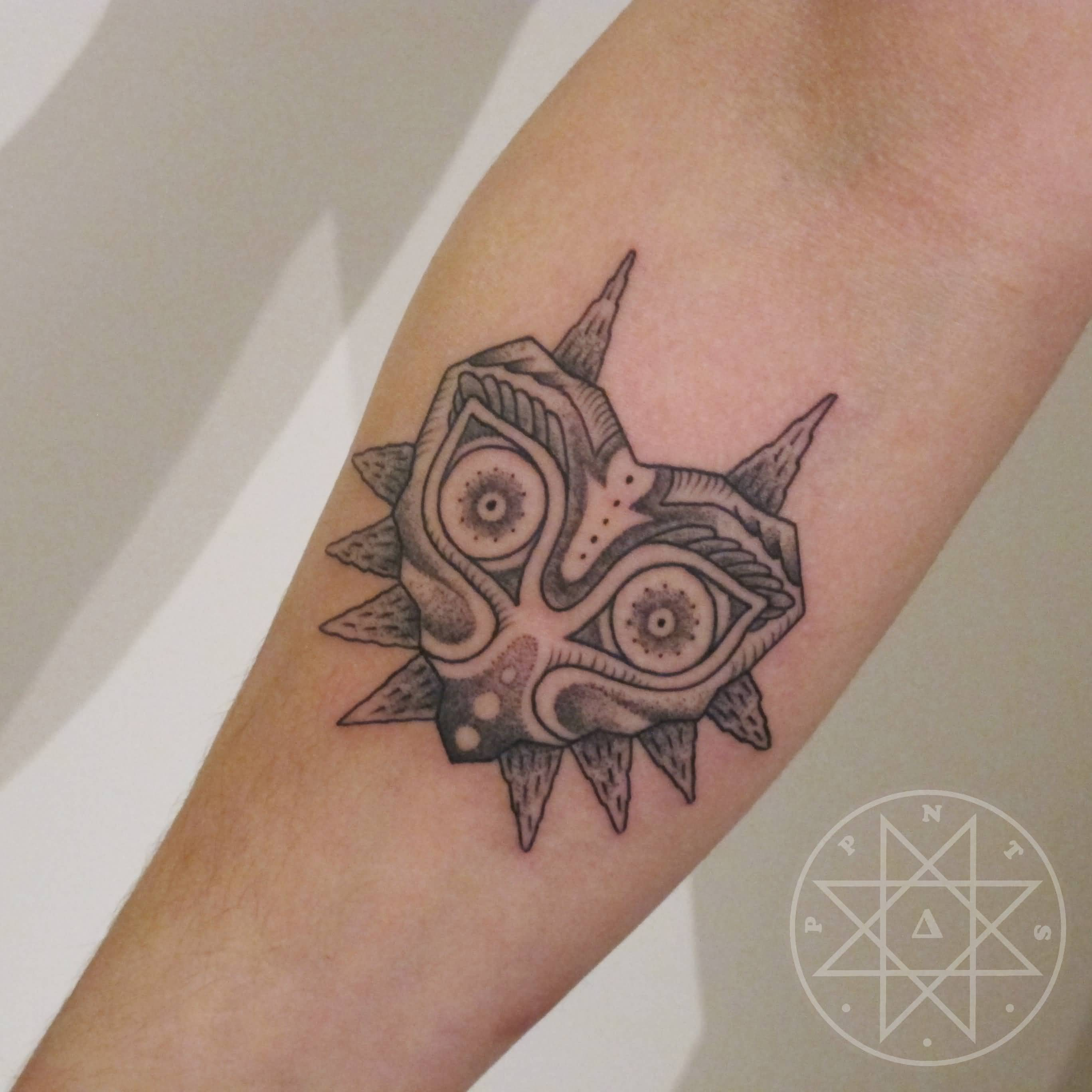Brilliant Majora Mask Tattoo On Forearm