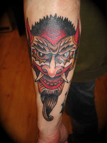 Coolest Devil Mask Tattoo Made On Calf