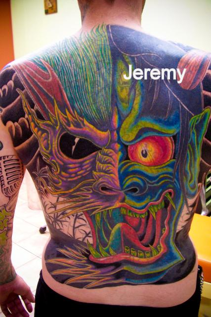 Famous Asian Mask Tattoo On Whole Back