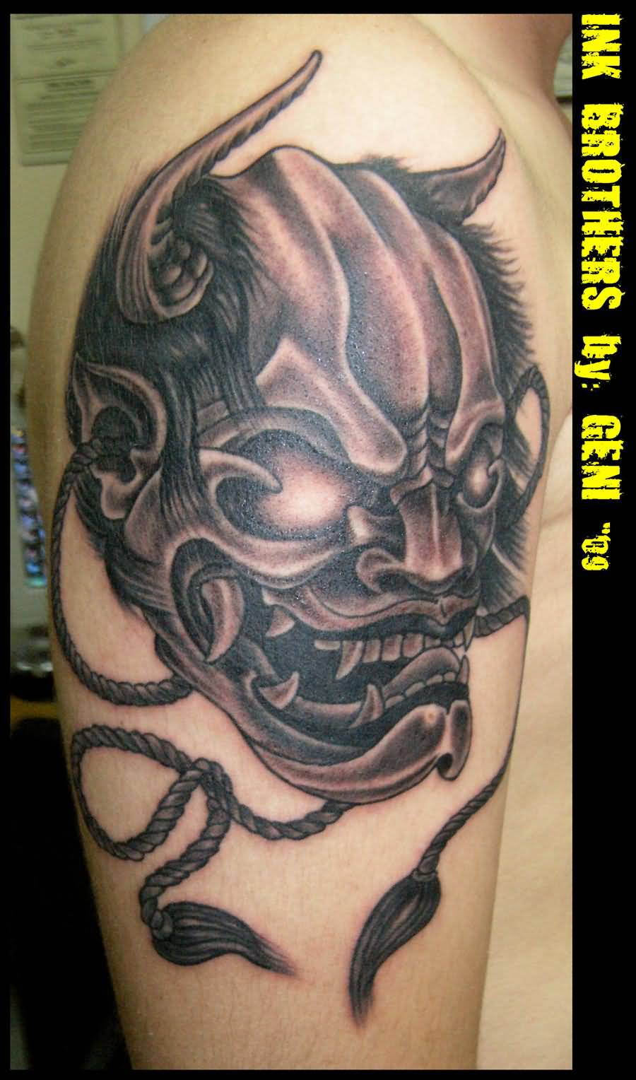 Famous Mask Tattoo Design On Upper Arm