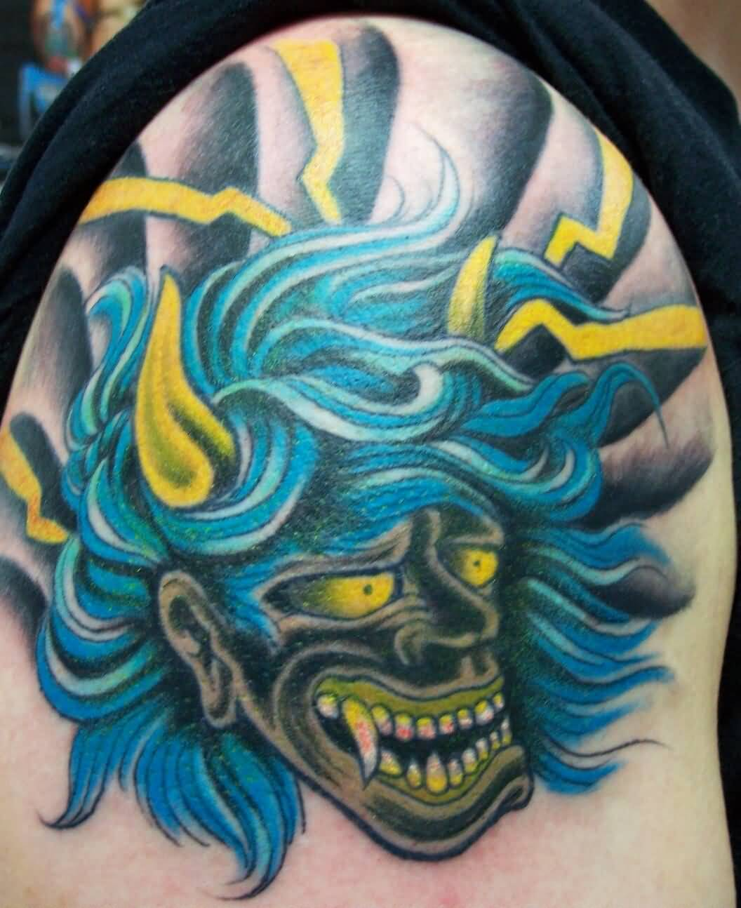 Groovy Mask Tattoo Made With Bluye Ink On Shoulder
