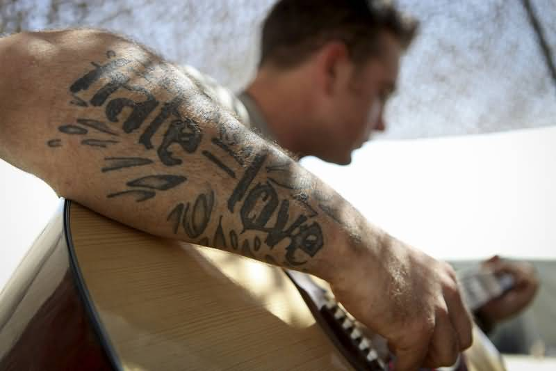 Vintage guns tattoo with love and hate wording for Love n hate tattoo