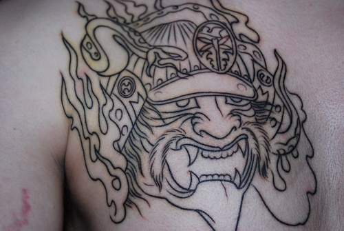Impressive Samurai Mask Tattoo On Chest