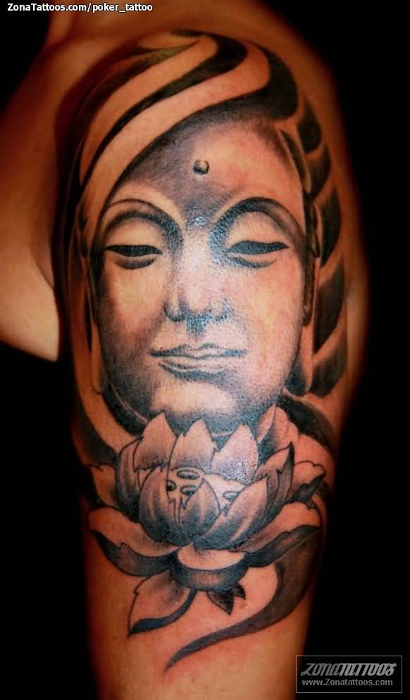 lotus and god face tattoo on shoulder