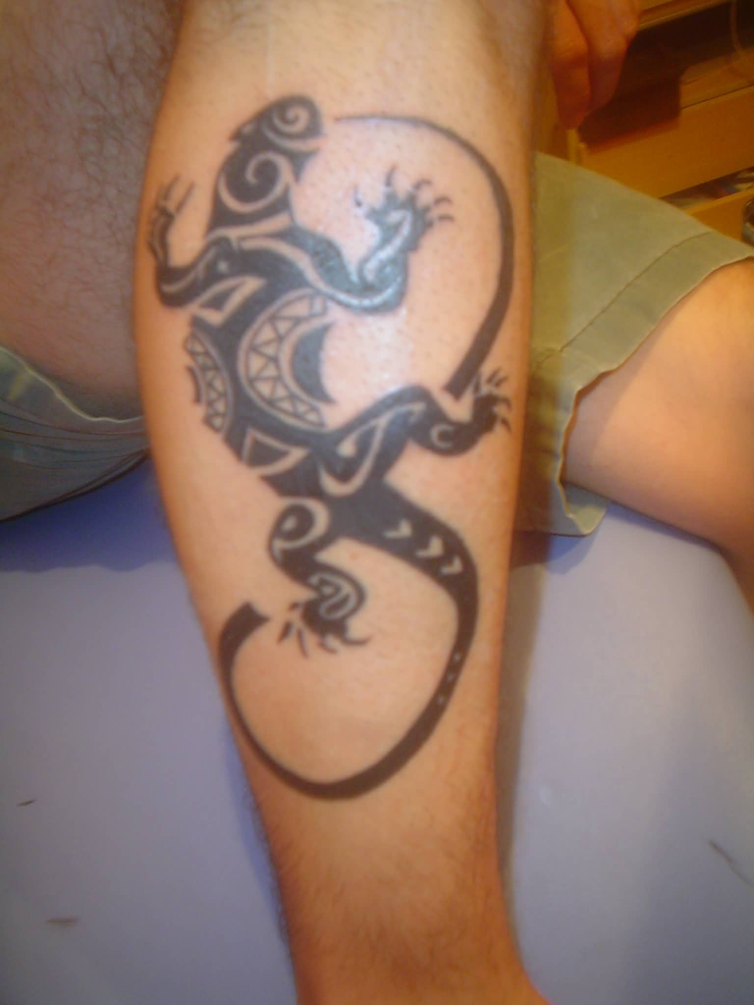 Maori Tattoo Of Lizard On Calf