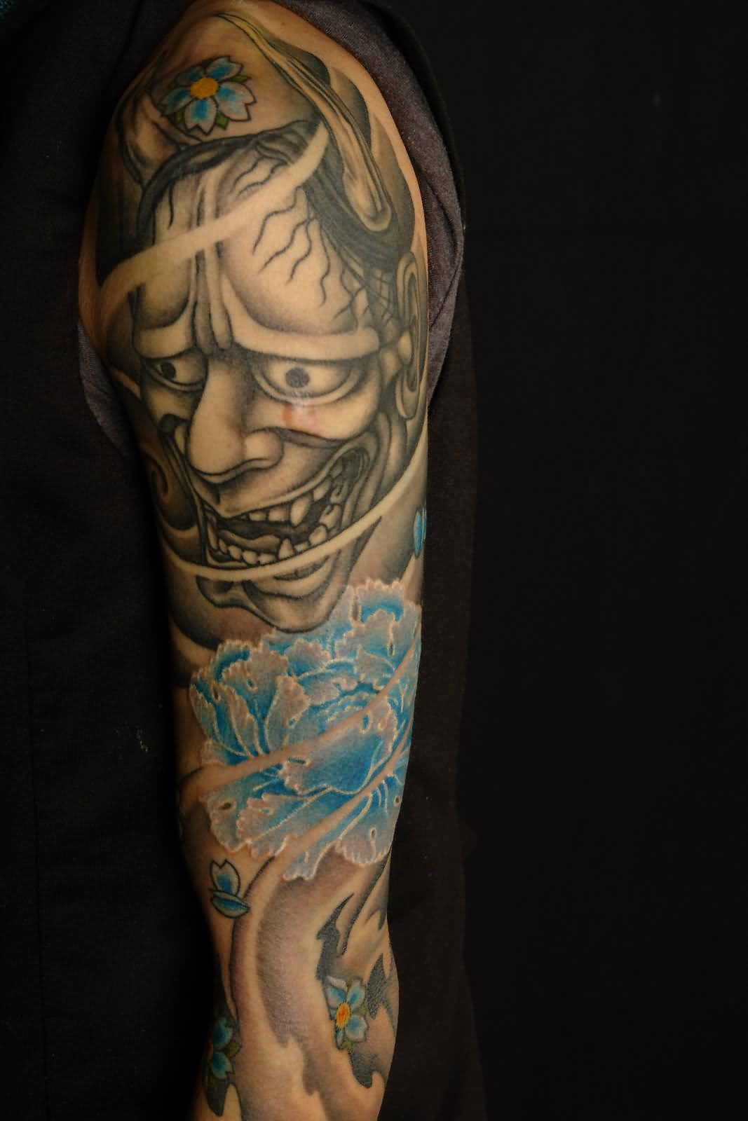 Perfect Tattoo Of Hannya With Blue Flower