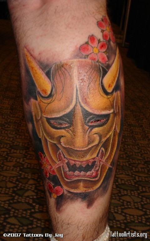 Popular Oni Mask Tattoo Made On Calf