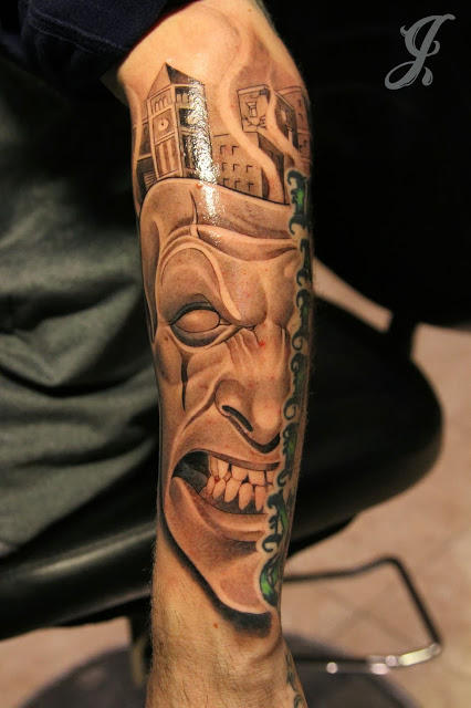 Scary face mask tattoo on forearm for Face mask tattoo