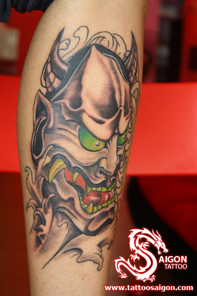 Scary Oni Mask Tattoo With Green Eyes