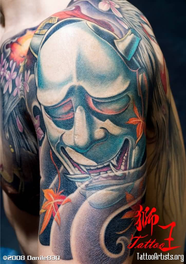 Smiling Oni Mask Tattoo On Arm
