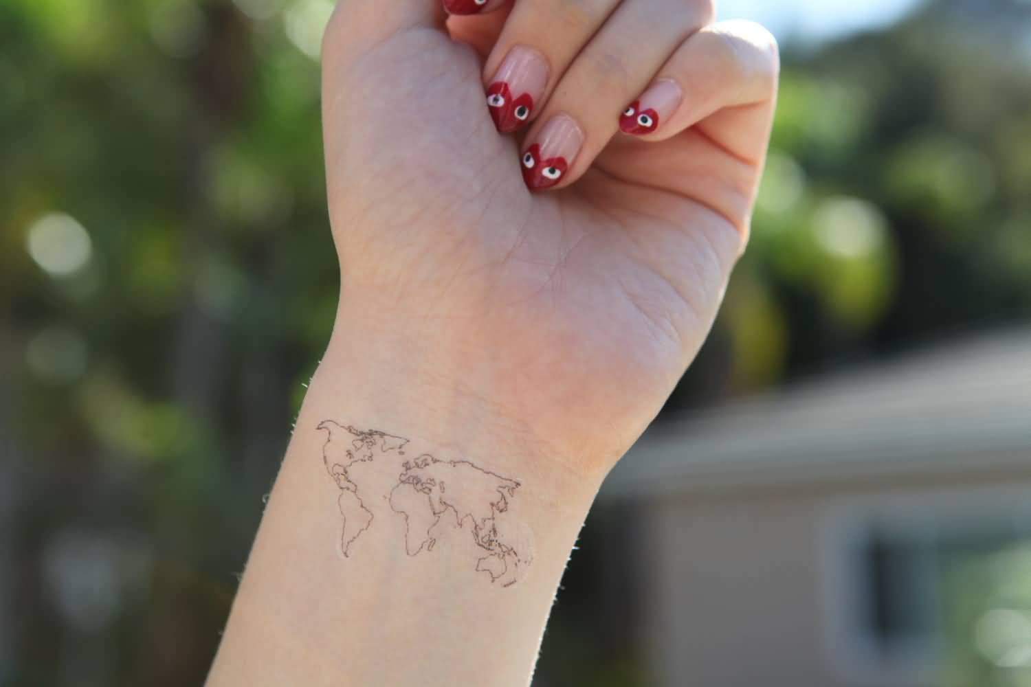 Superb Tattoo Of Map On Wrist