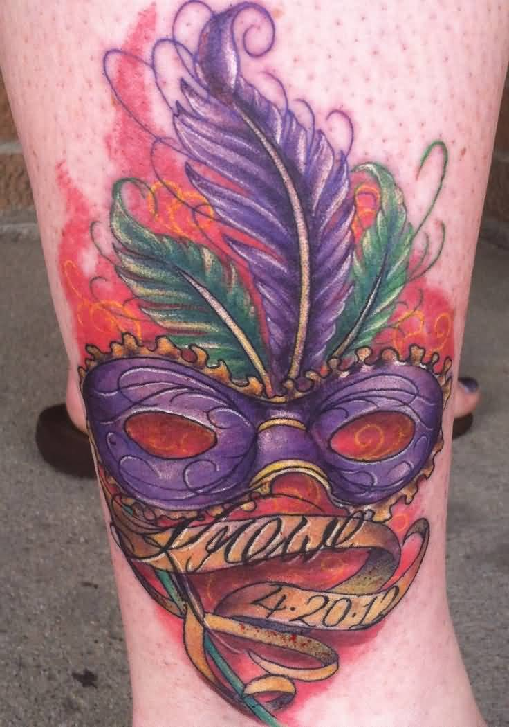 Ultimate Mask Tattoo And Feathers Design On Leg