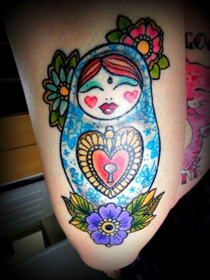 Attractive Matryoshka Doll And Lock Tattoo On Thigh