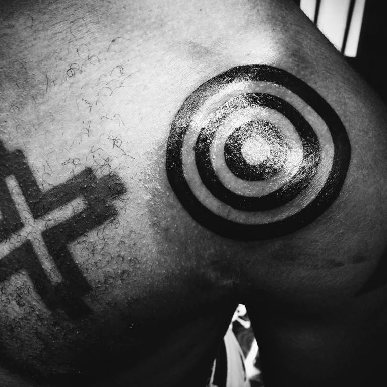 Fascinating Adinkrahene Symbol Tattoo Of African Men